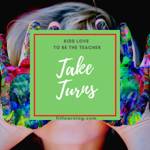 """Photo of a young child with messy hands with the words """"kids love to be the teacher. Take Turns"""" written over their face. This is a fluency instruction tip from a dyslexia tutor in St. Louis at Fit Learning St. Louis 63141"""