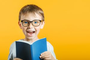 A smiling child wearing glasses looks into the camera. The could represent the joy from betting a personal academic best. Fit Learning offers support for young learners who might benefit from a private tutor in St. Louis, MO. Contact us to learning about Fit Tutoring and other services.