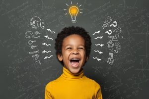 A laughing child has a light bulb flashing on above their head. This could symbolize a child having a lightbulb moment as a result of Fit Learning in St. Louis, MO. Contact us to learn more about Fit Tutoring and how a private tutor in St. Louis, MO can help your child with ADHD through ADHD tutoring in Saint Louis, MO