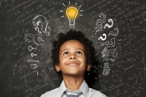 A young child smiles at the lightbulb illustration above their head. This could symbolize a child finally understanding a subject in school thanks to Fit Learning. Contact us today for ADHD tutoring in Saint Louis, MO.